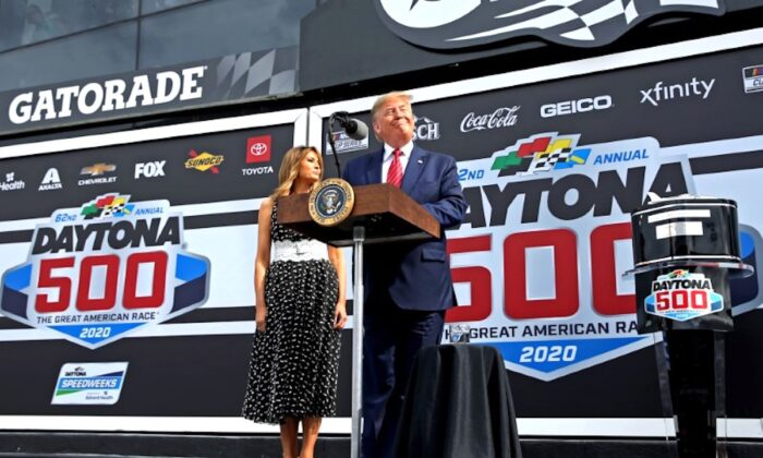 President Donald Trump with First Lady Melania Trump speaks before the Daytona 500 at Daytona International Speedway in Daytona Beach, Fla., on Feb 16, 2020. (Peter Casey/USA TODAY Sports via Reuters)