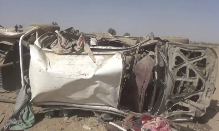 A destroyed vehicle is seen after an air strike in Al-Jawf province, Yemen, Feb. 15, 2020. (Houthi Media Centre/via Reuters)