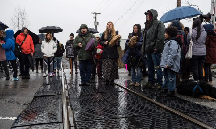 Protesters blockade CN Rail tracks in Vancouver on Feb. 15, 2020. (The Canadian Press/Darryl Dyck)