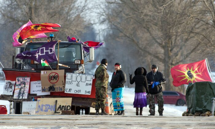 A rail blockade in Tyendinaga, near Belleville, Ont., on Feb. 16, 2020, in solidarity with the Wet'suwet'en hereditary chiefs opposed to the LNG pipeline in northern British Columbia. (The Canadian Press/Lars Hagberg)