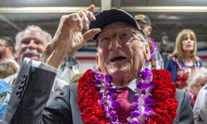 Donald Stratton, center, a USS Arizona survivor, acknowledges a friend at Kilo Pier next to the World War II Valor in the Pacific National Monument at Joint Base Pearl Harbor-Hickam in Honolulu, on Dec. 7, 2016. (AP Photo/Eugene Tanner, File)