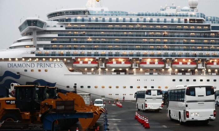 Two buses arrive next to the Diamond Princess cruise ship, with people quarantined onboard due to fears of the new coronavirus, at the Daikaku Pier Cruise Terminal in Yokohama port in Japan, on Feb. 16, 2020. (Behrouz Mehri/AFP via Getty Images)