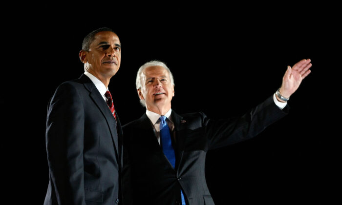 President Barack Obama (L) and Vice-President Joe Biden acknowledge their supporters after Obama gave his victory speech during an election night gathering in Grant Park in Chicago, Ill., on Nov. 4, 2008. (Joe Raedle/Getty Images)
