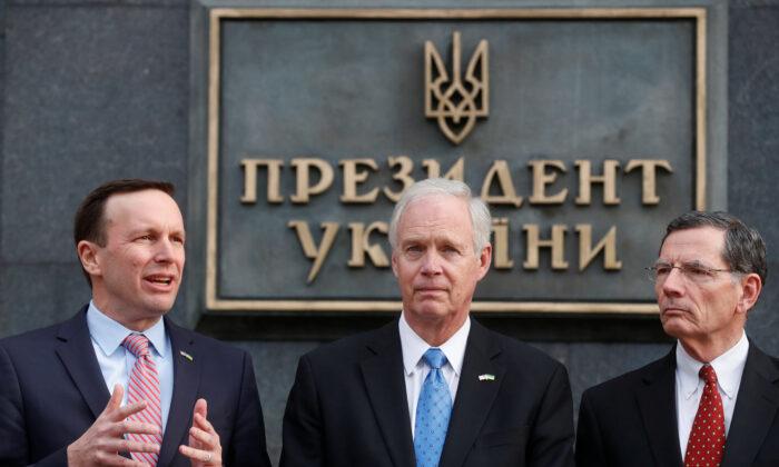 U.S. Senators Ron Johnson, John Barrasso, and Chris Murphy attend a news briefing following their meeting with Ukrainian President Volodymyr Zelenskiy in Kiev on Feb. 14, 2020. (Valentyn Ogirenko/Reuters)