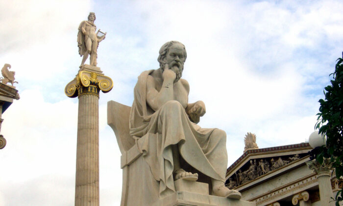 A statue of ancient Greek philosopher Socrates in front of the Academy of Athens in Greece. Traditionalists have a well-grounded intuition that the customs and practices they follow have been rationally and empirically demonstrated over time. (Dimsfikas at Greek Wikipedia/cc-by-2.0)