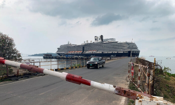 A general view of the security checkpoint in front of cruise ship MS Westerdam at dock in the Cambodian port of Sihanoukville, Cambodia, on Feb. 17, 2020. (Clare Baldwin/Reuters)
