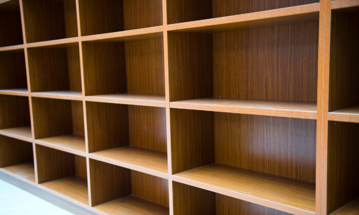 Stock image showing empty bookshelves. (Illustration/Shutterstock)