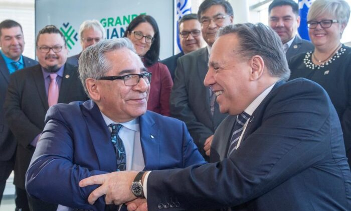 Quebec Premier Francois Legault (R) shakes hands with Chairman of the Cree Nation Government Abel Bosum after signing a Memorandum of Understanding on collaborative, long-term economic development at a news conference in Montreal, on Feb. 17, 2020. (Ryan Remiorz/Canadian press)