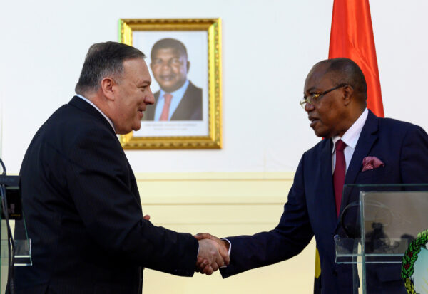 U.S. Secretary of State Mike Pompeo and Angolan Foreign Minister Manuel Domingos Augusto shake hands after a news conference the at Ministry of Foreign Affairs in Luanda, Angola February 17, 2020. (Andrew Caballero-Reynolds/Pool via Reuters)