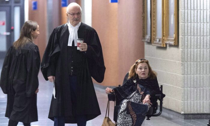 Nicole Gladu, who is incurably ill, and her lawyer Jean-Pierre Menard arrive at the courthouse in Montreal on Jan. 7, 2019, for the beginning of a trial challenging provincial and federal laws on medically assisted death on the grounds they are too restrictive. (The Canadian Press/Paul Chiasson)