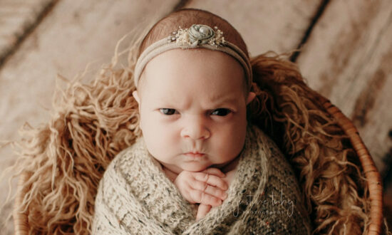 Baby's Grouchy Facial Expressions During Photoshoot Take Over the Internet, and Her Parents Love It