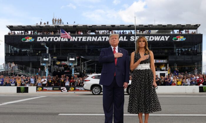 President Donald Trump and First Lady Melania Trump stand for the national anthem prior to the NASCAR Cup Series 62nd Annual Daytona 500 at Daytona International Speedway in Daytona Beach, Fla., on Feb. 16, 2020. (Chris Graythen/Getty Images)