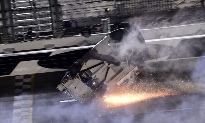 Ryan Newman, driver of the #6 Koch Industries Ford, flips over as he crashes during the NASCAR Cup Series 62nd Annual Daytona 500 at Daytona International Speedway in Daytona Beach, Florida, on Feb. 17, 2020. (Jared C. Tilton/Getty Images)