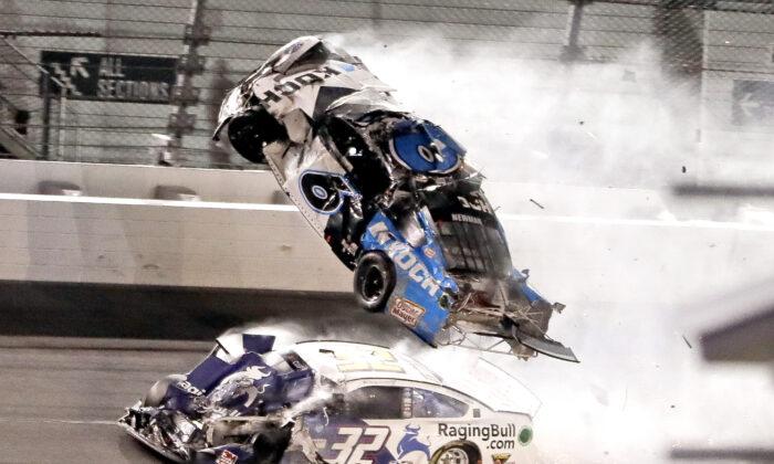 Ryan Newman (6) goes airborne as Corey LaJoie (32) crashes in to him on the final lap of the NASCAR Daytona 500 auto race at Daytona International Speedway, in Daytona Beach, Fla., on Feb. 17, 2020. (John Raoux/AP Photo)