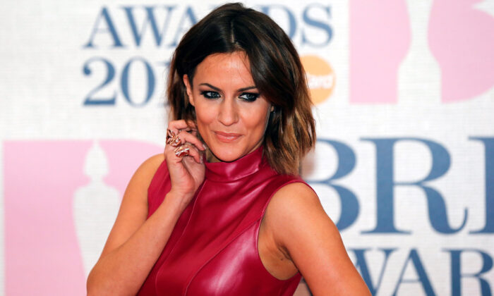 Television presenter Caroline Flack arrives for the BRIT music awards at the O2 Arena in Greenwich, London, on Feb. 25, 2015. (Suzanne Plunkett/File Photo/Reuters)