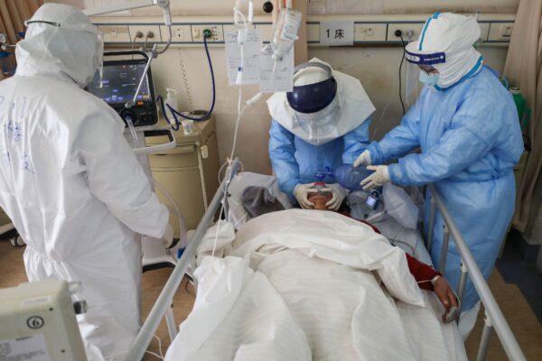 Medical staff members treating a coronavirus patient
