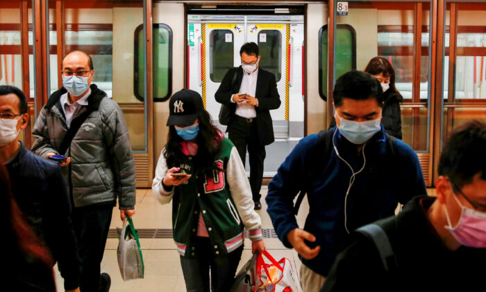 People wear protective masks following the outbreak of a new coronavirus, during their morning commute in a station, in Hong Kong, China on Feb. 10, 2020. (Tyrone Siu/Reuters)