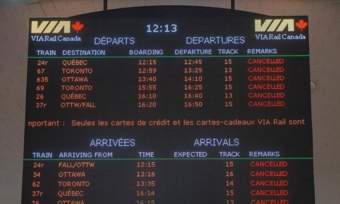 Cancelled rail arrivals and departures are listed on the board at Central Station in Montreal, Canada, on Feb. 14, 2020. (Ryan Remiorz/TheCanadianPress)