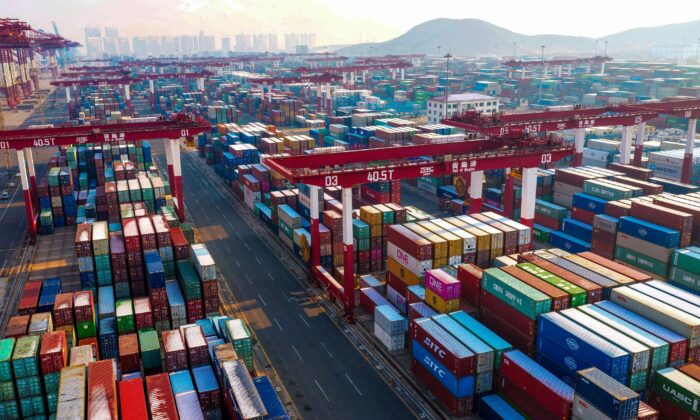 Containers are seen stacked at a port in Qingdao in China's eastern Shandong Province on Jan. 14, 2020. (STR/AFP via Getty Images)