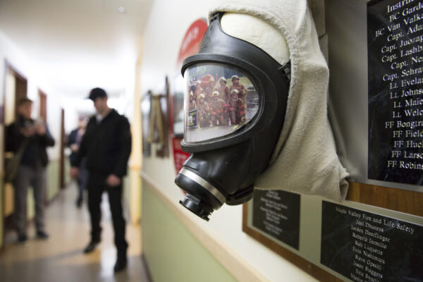 A self-contained breathing apparatus and a photo of recruits inside a Washington State Patrol Fire Training Academy dormitory