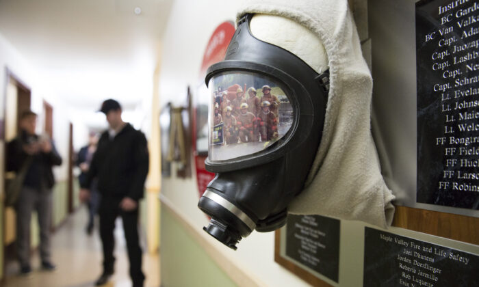 A self-contained breathing apparatus and a photo of recruits inside a Washington State Patrol Fire Training Academy dormitory which has been designated as a Novel Coronavirus quarantine site, in Washington on Feb. 6, 2020. (Jason Redmond/AFP via Getty Images)