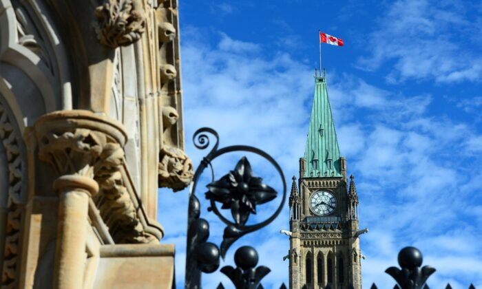 The Peace Tower is seen from the front gates of Parliament Hill in Ottawa in a file photo. (The Canadian Press/Sean Kilpatrick)
