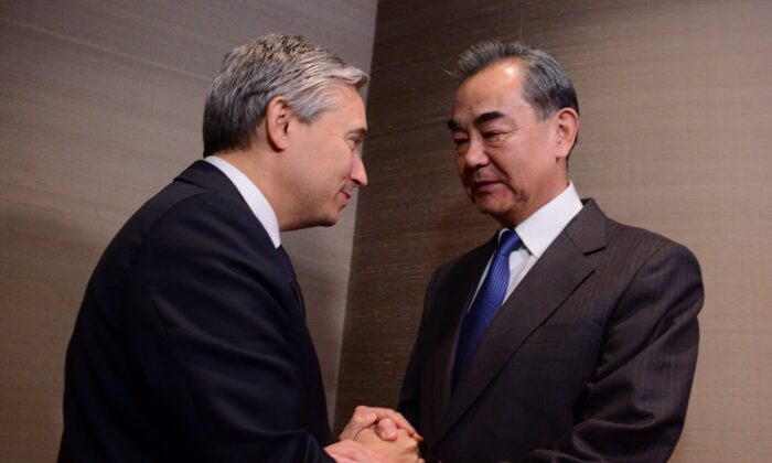 Foreign Affairs Minister Francois-Philippe Champagne shakes hands with Chinese Foreign Minister Wang Yi on the sidelines of the Munich Security Conference in Munich, Germany, on Feb. 14, 2020. (The Canadian Press/Sean Kilpatrick)