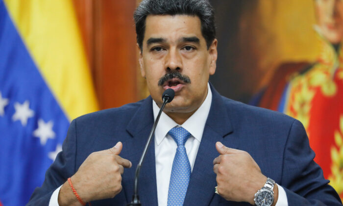 Venezuelan dictator Nicolas Maduro gives a press conference at Miraflores presidential palace in Caracas, Venezuela, on Feb. 14, 2020. (Ariana Cubillos/AP Photo)
