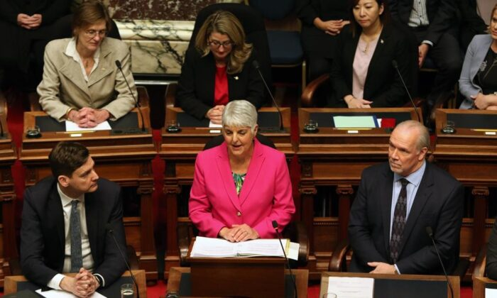 Attorney General David Eby and Premier John Horgan look on as Minister of Finance Carole James delivers the budget speech from the legislative assembly at B.C. Legislature in Victoria, B.C., on Feb. 18, 2020. (Chad Hipolito/The Canadian Press)