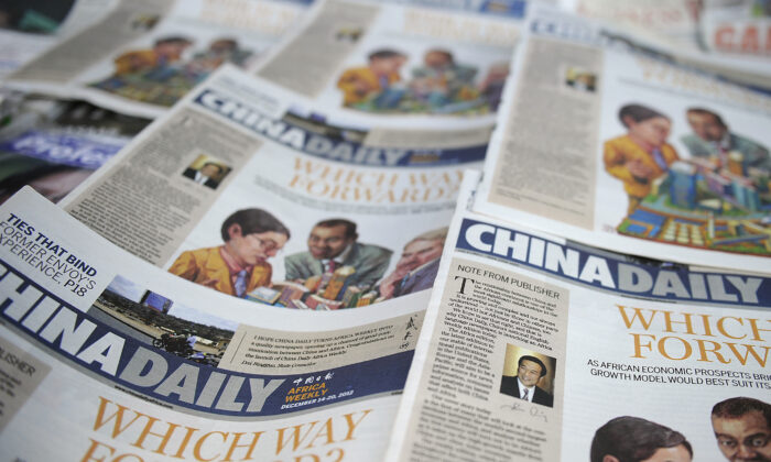 Copies of the Africa edition of the China Daily newspaper sits on a newsstand in the Kenyan capital Nairobi on Dec. 14, 2012. (Tony Karumba/AFP via Getty Images)