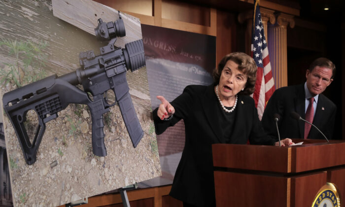 "Sen. Dianne Feinstein (D-Calif.) and Sen. Richard Blumenthal (D-Conn.) points to a photograph of a rifle with a ""bump stock"" during a news conference to announce proposed gun control legislation at the U.S. Capitol in Washington on Oct. 4, 2017. (Chip Somodevilla/Getty Images)"