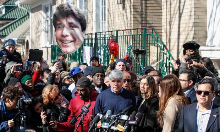 Former Illinois governor Rod Blagojevich speaks next to his wife Patricia Blagojevich outside of their house in Chicago, Illinois, on Feb. 19, 2020. (Kamil Krzaczynski/AFP via Getty Images)