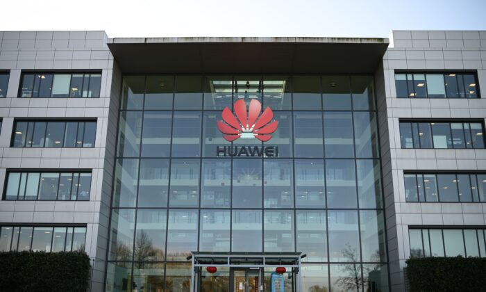 A photograph shows the logo of Chinese company Huawei at their main UK offices in Reading, west of London, on Jan. 28, 2020. (DANIEL LEAL-OLIVAS/AFP via Getty Images)