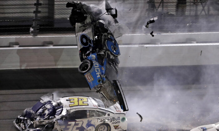 Ryan Newman (6) goes airborne after crashing into Corey LaJoie (32) during the NASCAR Daytona 500 auto race at Daytona International Speedway in Daytona Beach, Fla., on Feb. 17, 2020. (Chris O'Meara/AP Photo)