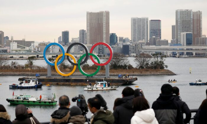 Giant Olympic Rings are installed at the waterfront area, with the Rainbow Bridge in the background at Odaiba Marine Park in Tokyo, Japan, on Jan. 17, 2020. (Issei Kato/Reuters/File Photo)