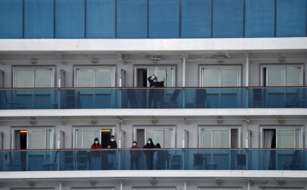 Passengers stand on the cruise ship Diamond Princess at Daikoku Pier Cruise Terminal in Yokohama