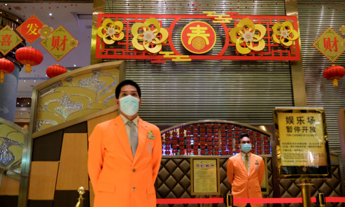 Security guards stand outside the closed Grand Lisboa casino, following the coronavirus outbreak in Macau, China on Feb. 4, 2020. (Tyrone Siu/Reuters)