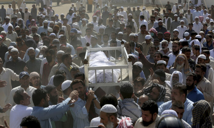 People carry the body of a victim of a toxic gas leak, during his funeral prayer, in Karachi, Pakistan, on Feb. 17, 2020. (Fareed Khan/AP Photo)