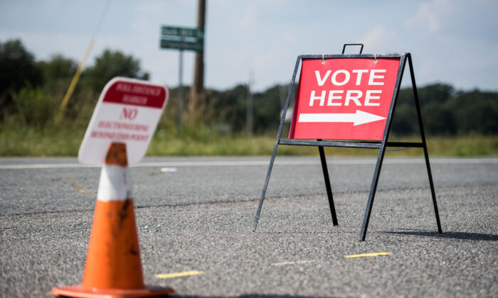 A sign directs voters outside of a polling station during the special election between Democrat Dan McCready and Republican Dan Bishop in North Carolina's 9th Congressional District in Marshville, North Carolina, on Sept. 10, 2019. (Sean Rayford/Getty Images)