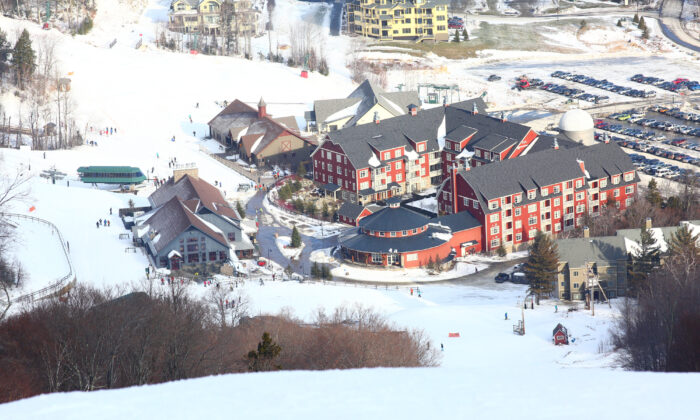 The view of Sugarbush's main base, Lincoln Peak Village, anchored by the barn-red, luxurious yet unpretentious Claybrook Hotel. (Abby Sessock/ Sugarbush Resort and Alterra Mountain Company)