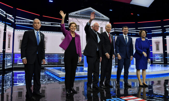 Democratic presidential candidates (L-R) former New York City Mayor Mike Bloomberg, Sen. Elizabeth Warren (D-Mass.), Sen. Bernie Sanders (I-Vt.), former Vice President Joe Biden, former South Bend, Indiana Mayor Pete Buttigieg, and Sen. Amy Klobuchar (D-Minn.) arrive on stage for the Democratic presidential primary debate in Las Vegas, Nev., on Feb. 19, 2020. (Ethan Miller/Getty Images)