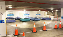 Homeless Sleep on Real Beds in Empty Parking Garage Thanks to Safe Overnight Shelter Program