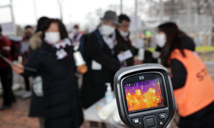 Vissel Kobe fans are tested for signs of the coronavirus  in Suwon, South Korea, on Feb. 19, 2020. (Han Myung-Gu/Getty Images)