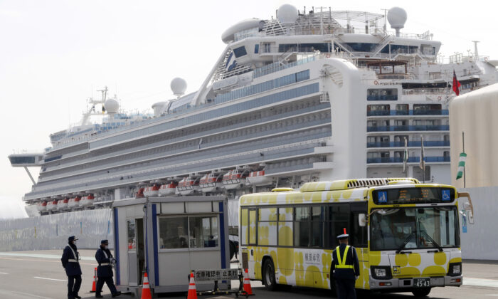 A bus carrying passengers from the quarantined Diamond Princess cruise ship leaves a port in Yokohama, near Tokyo on Feb. 20, 2020. (Eugene Hoshiko/AP Photo)