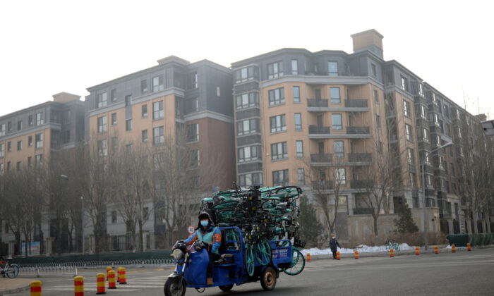 A worker drives a vehicle carrying bicycles from Didi Chuxing's bike sharing service in the morning after the extended Lunar New Year holiday caused by the novel coronavirus outbreak, near Zhongguancun Software Park, in Beijing, China on Feb. 10, 2020. (Tingshu Wang/Reuters)