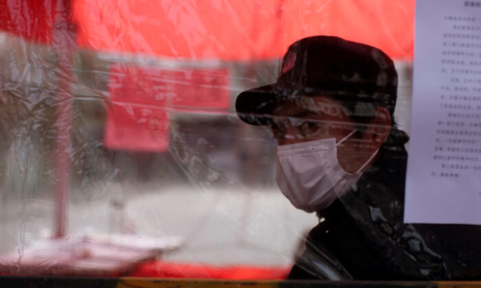 A man wearing face mask is seen in Qibao, an old river town on the outskirts of Shanghai, China, as the country is hit by an outbreak of the novel coronavirus, on Feb. 19, 2020. (Aly Song/Reuters)