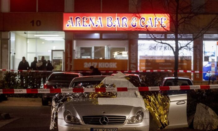 A car with dead bodies stands in front of a bar in Hanau, Germany, on Feb. 20, 2020. (AP Photo/Michael Probst)