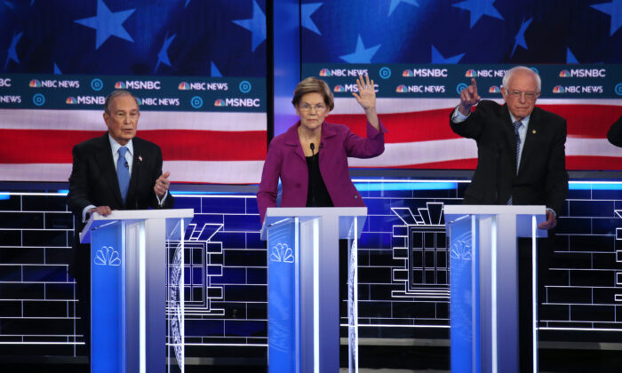 Democratic presidential candidates (L–R) former New York City Mayor Mike Bloomberg speaks as Sen. Elizabeth Warren (D-Mass.), and Sen. Bernie Sanders (I-Vt.) react during the Democratic presidential primary debate at Paris Las Vegas on Feb. 19, 2020. (Mario Tama/Getty Images)