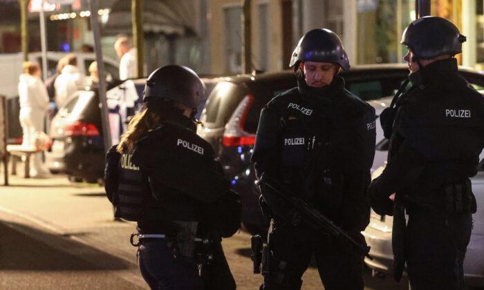 Police officers secure the area after a shooting in Hanau near Frankfurt, Germany, on Feb. 19, 2020.  (Kai Pfaffenbach/Reuters)