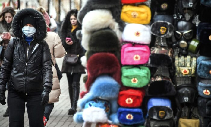 A person wearing a face mask walks along Arbat street in downtown Moscow on Feb. 19, 2020. (Alexander Nemenov/AFP via Getty Images)